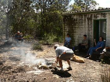 OVERBERG REGION (52) -  HR GRAHAM  TENDING BRAAI FIRE AT VLEIHUIS