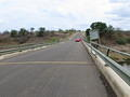 Three young ladies getting out of their car on Letaba Bridge before (not between) the yellow lines